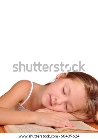 Girl asleep on the book - stock photo