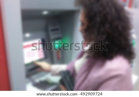 Girl at ATM blurred.