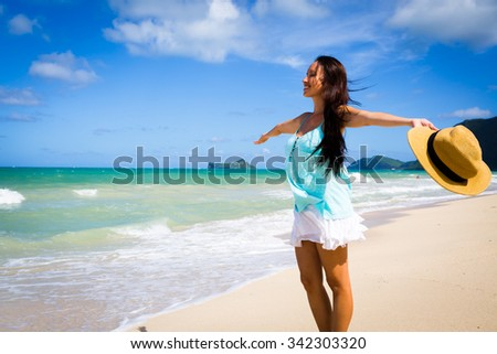 Girl at Beach with Hat