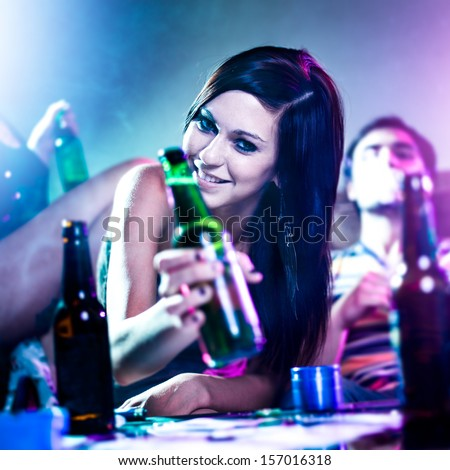 girl at drug fueled house party with beer bottle. - stock photo