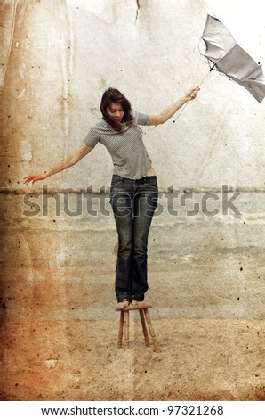 girl at seaside. Photo in old color image style. - stock photo