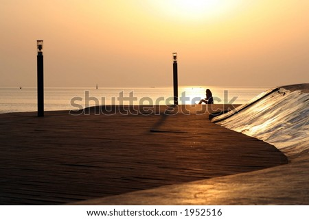 Girl at sunrise - stock photo