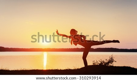 girl at sunset by the lake