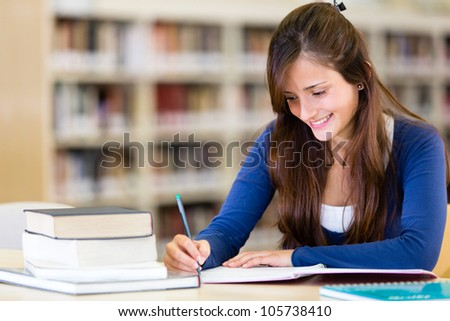 Girl at the library studying with books