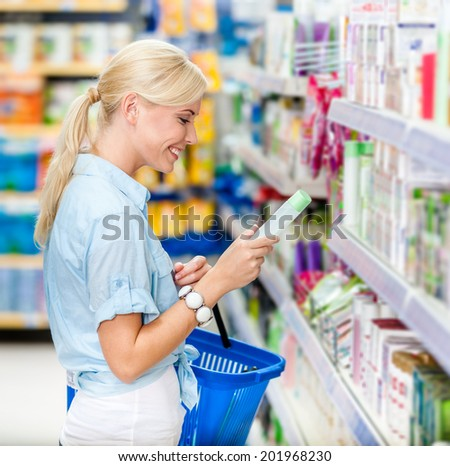 Girl at the market choosing cosmetics among the great variety of products. Concept of consumerism, retail and purchase - stock photo