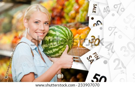 Girl at the market choosing fruits and vegetables hands watermelon on sale thumbs up - stock photo