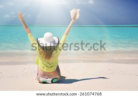 Girl at the ocean. Great Exuma, Bahamas - stock photo