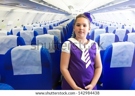 Girl at the plane - stock photo