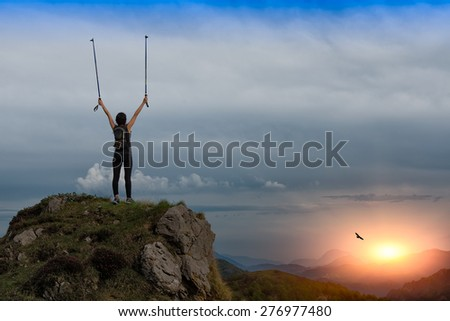 Girl at the top of the mountain during sunset