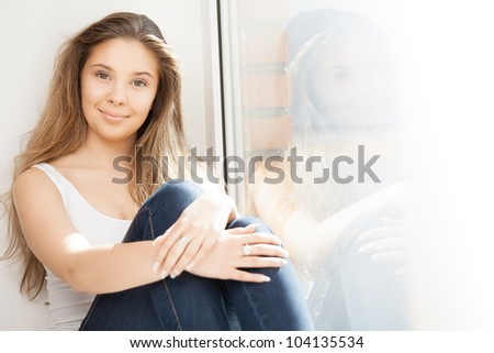 Girl at window - stock photo