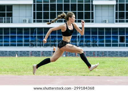 girl athlete execution of the triple jump - stock photo