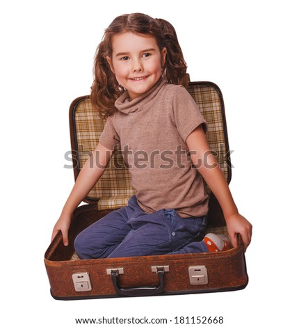 girl baby brunette sitting in a suitcase for travel isolated on white background - stock photo