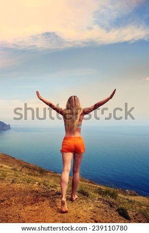 girl back at the sea - stock photo
