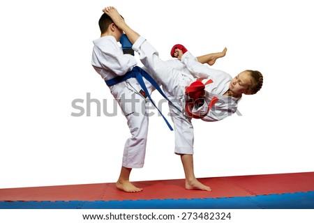 Girl beats boy kicked in the head - stock photo