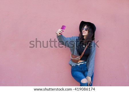 girl becoming a selfie with mobile