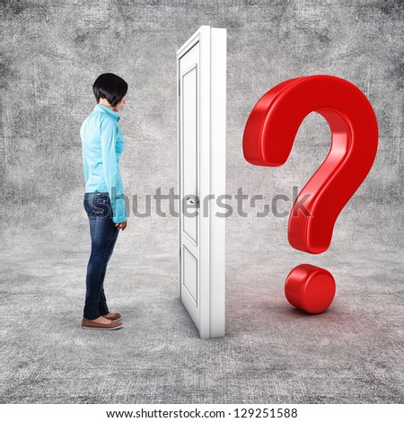 Girl before a white door in fear of the unknown - stock photo