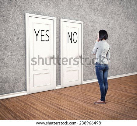 Girl before a white doors in fear of the unknown - stock photo