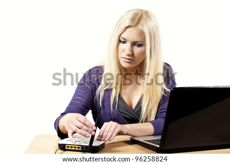 Girl behind the desk with a laptop
