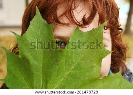 Girl behind the leaf - stock photo