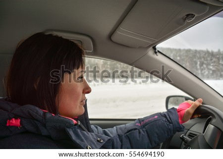 girl behind the wheel of a car