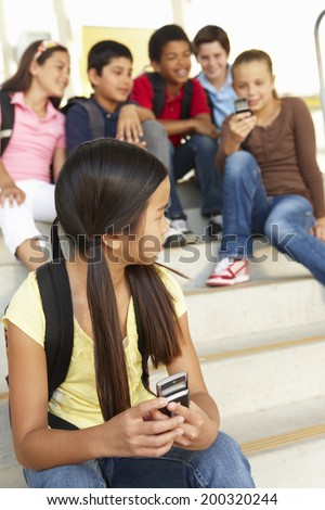 Girl being bullied in school - stock photo