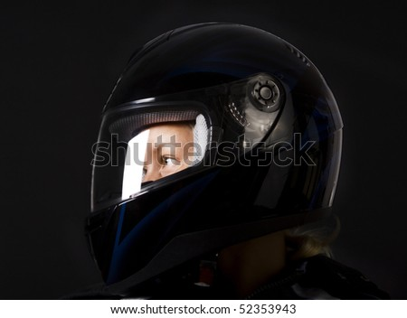 girl biker wearing helmet and posing - stock photo
