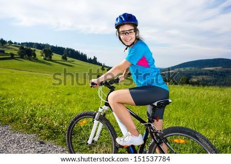 Girl biking  - stock photo
