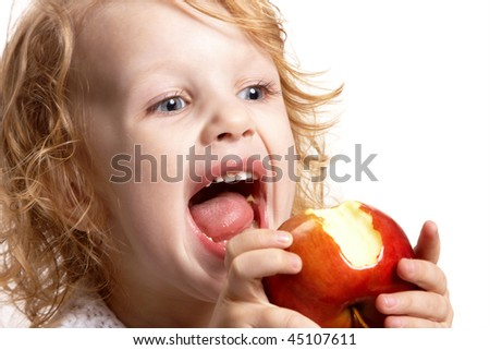 girl bites an red apple - stock photo