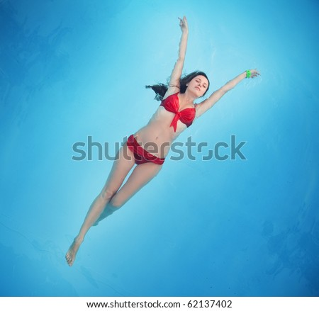 Girl blissful in the pool - stock photo