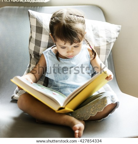 Girl Book Casual Home Kindergarten Offspring Concept - stock photo