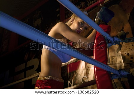 girl boxer in boxing ring in professional female boxing