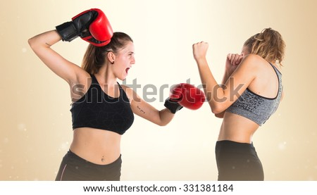 Girl boxing with his friend