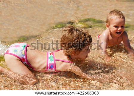 girl, boy, brother, sister, sea, vacation, summer, ocean, sand, travel - stock photo