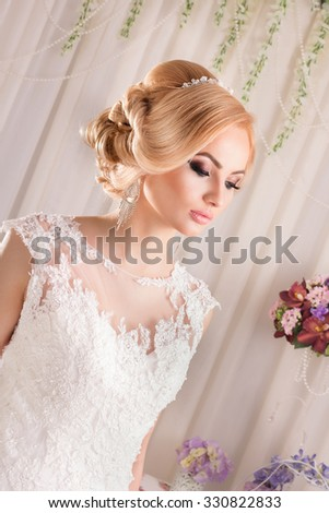 Girl bride woman in wedding dress with elegant hairstyle. Young beautiful bride