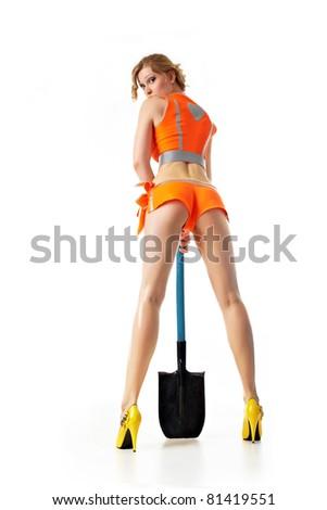 Girl-builder looks back - stock photo