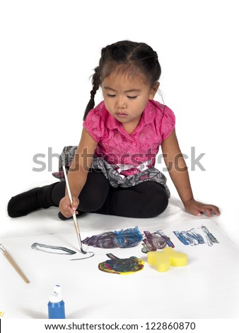 Girl busy painting against white background.