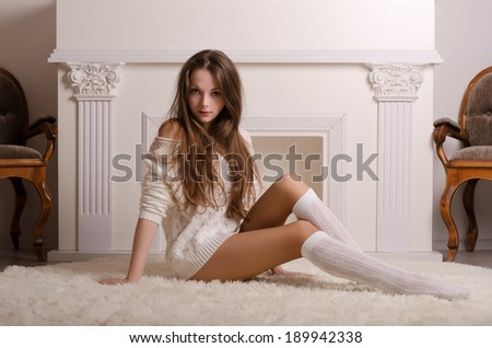 girl by the fireplace
