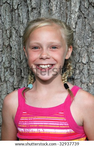 girl by tree - stock photo