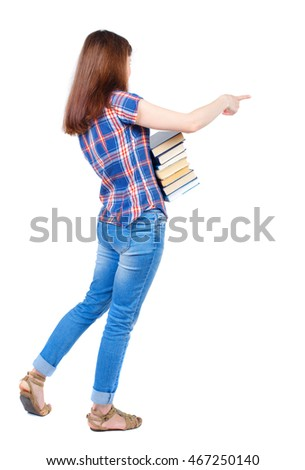 Girl carries a heavy pile of books. back view.  Rear view people collection.  backside view of person.  Isolated over white background. Girl in plaid shirt cancer is holding a stack of books and