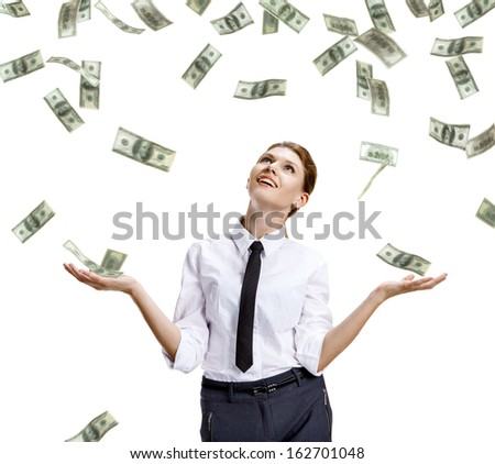 Girl catches the falling money / stock image of money falling around happy businesswoman - isolated on white background  - stock photo