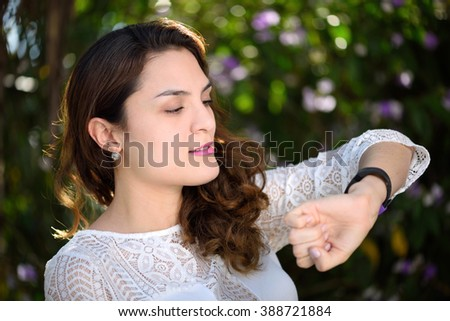 Girl checking the time on her watch
