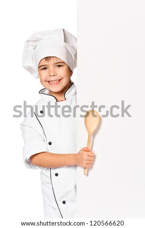 girl chef with large spoon peeking behind empty board. Isolated on white - stock photo