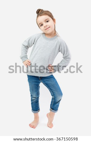 Girl child barefoot in jeans and a gray sweater without image. Imitates adult models For your design available space. other clothing for children and adults in my portfolio. gray background