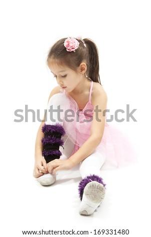 Girl child dressed in ballerina costume. Isolated on white - stock photo
