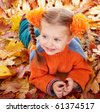 Girl child in autumn orange leaves. Outdoor. - stock photo