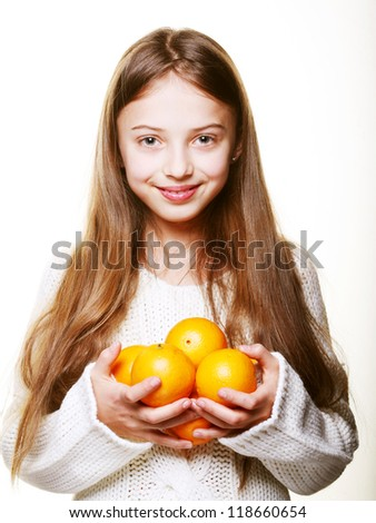Girl child with an oranges - stock photo