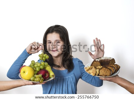 Girl choose to eat organic fruits - grapes, apples, pears - stock photo