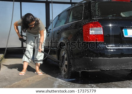 girl cleaning her car