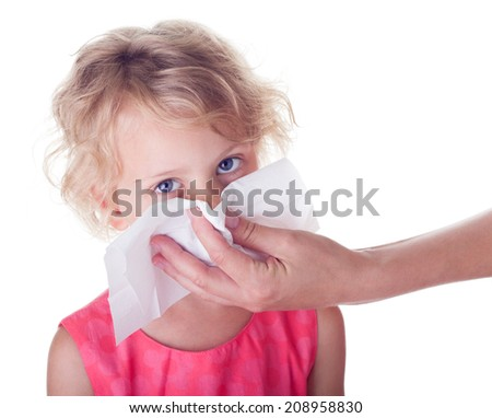 Girl cleaning  her nose with tissue isolated on white