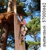 Girl climbing in adventure park - stock photo
